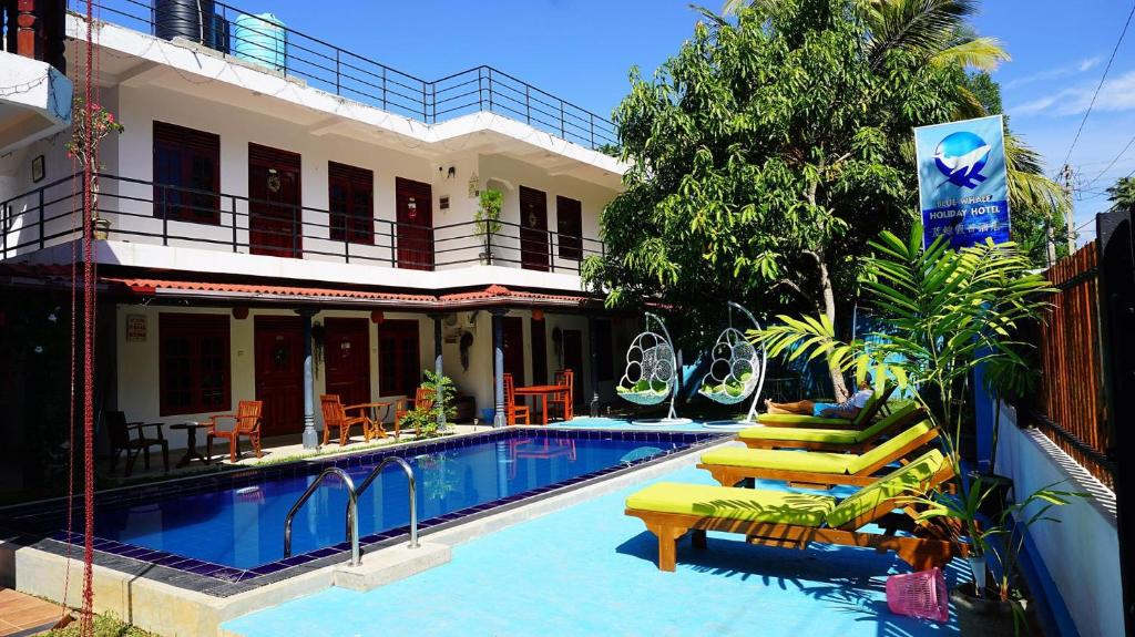 The swimming pool at or close to Blue Whale Holiday Hotel