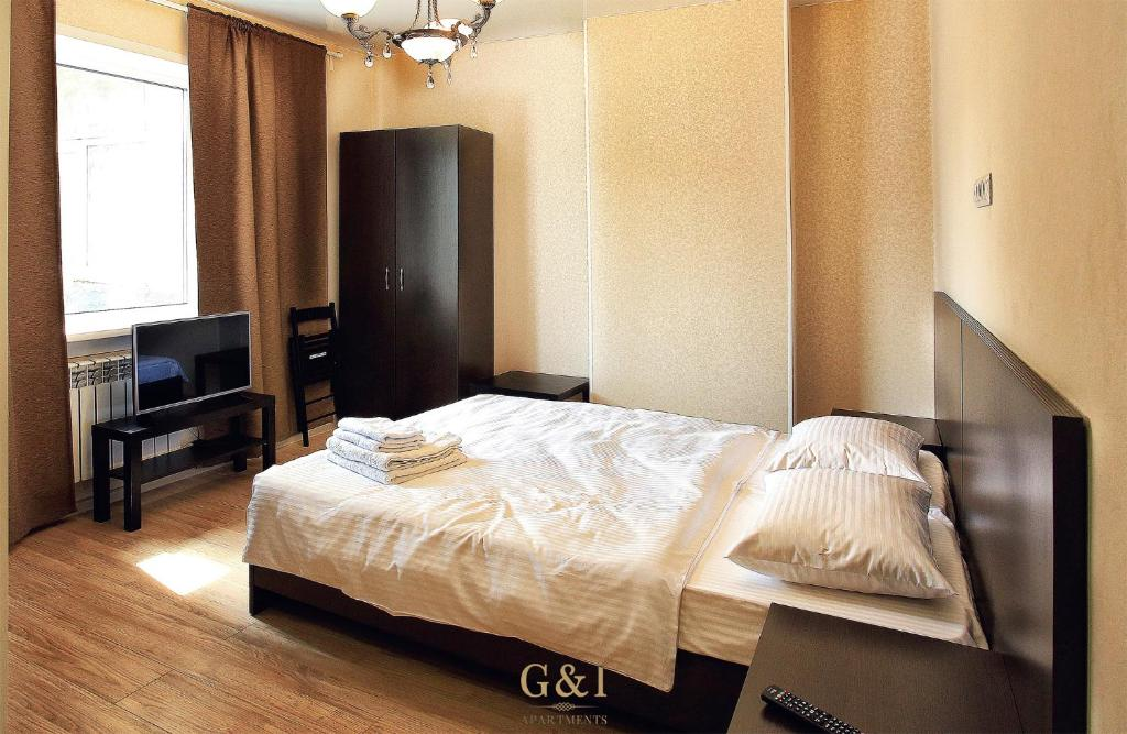 A bed or beds in a room at Apartment G&I