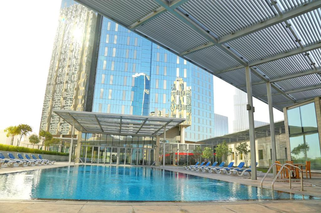 The swimming pool at or near Yallarent DIFC - Central Park Apartments