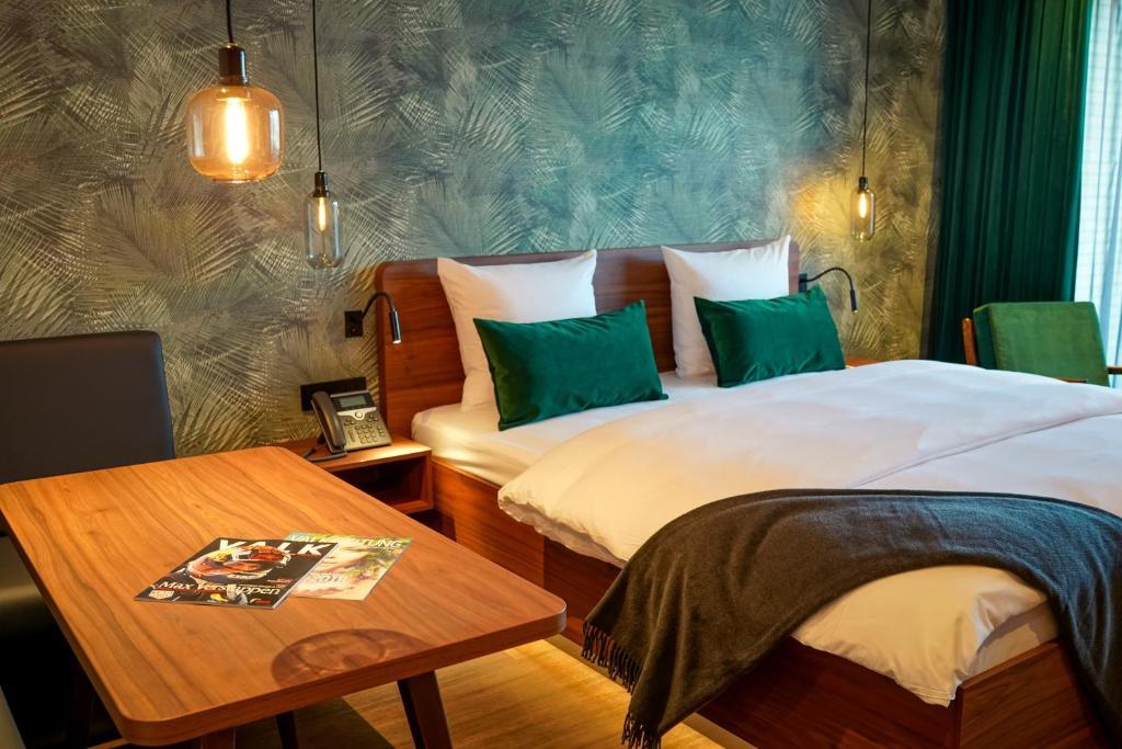 A bed or beds in a room at Van der Valk Hotel Berlin Brandenburg
