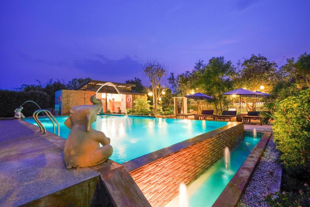 The swimming pool at or near Vieng Tawan Sukhothai Guesthouse by Thai Thai (Adult Only)