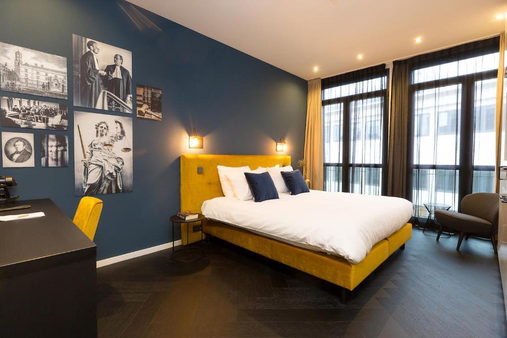 Een bed of bedden in een kamer bij Court Hotel City Centre Utrecht