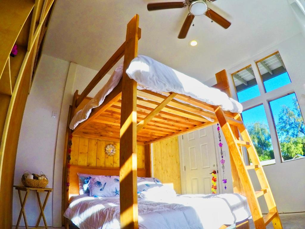 A bunk bed or bunk beds in a room at Lolia Community