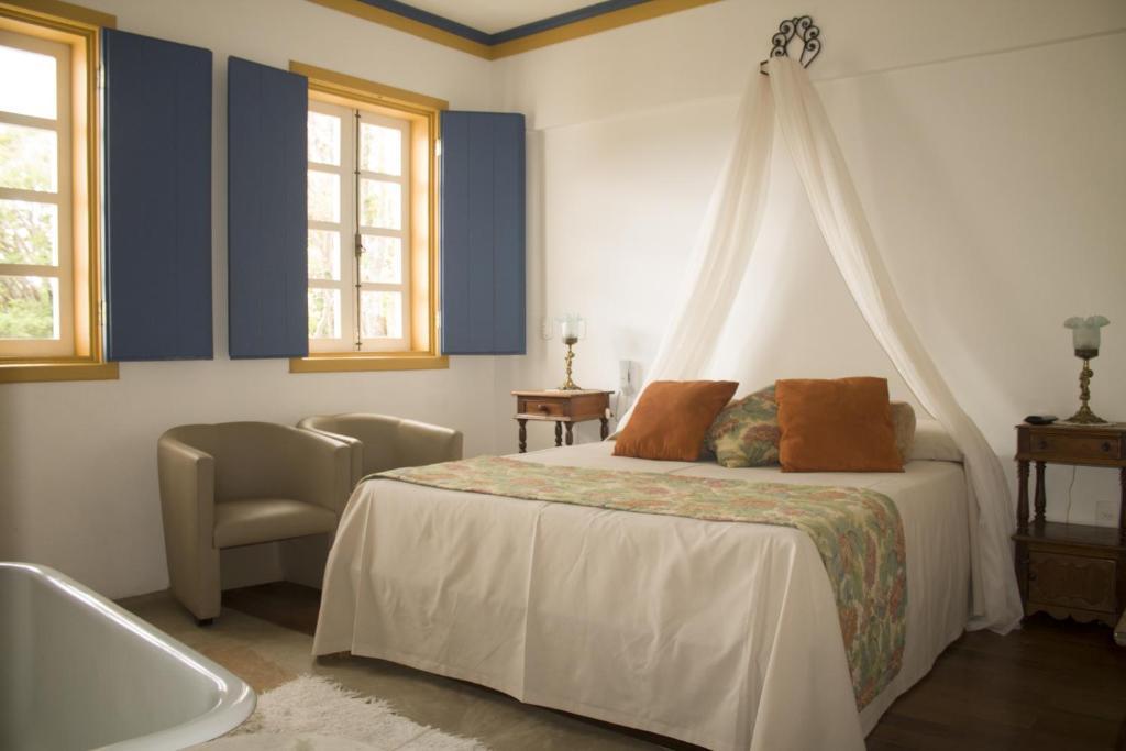 Cama ou camas em um quarto em Pousada Relíquias do Tempo