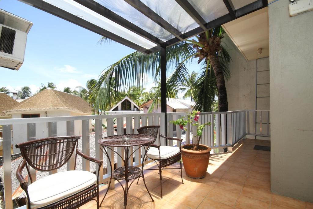 Ein Balkon oder eine Terrasse in der Unterkunft MR Holidays Hotel