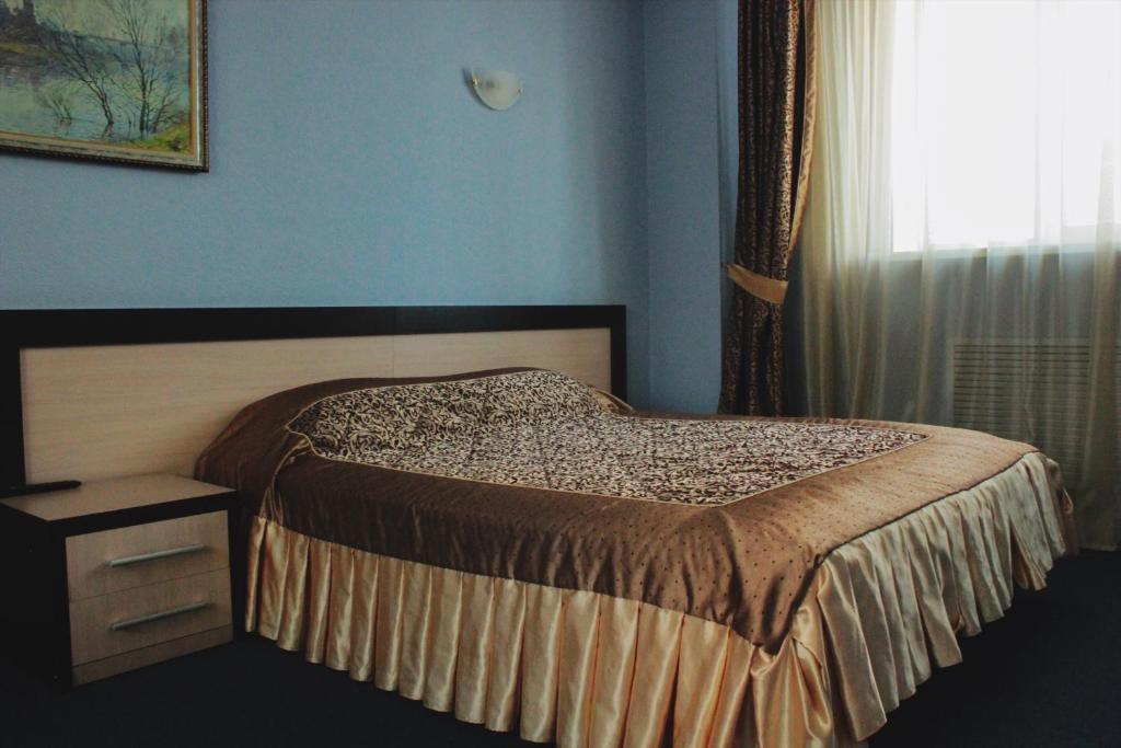 Кровать или кровати в номере Отель Талисман