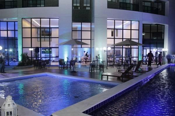 The swimming pool at or near Flat Rosarinho Prince Premium