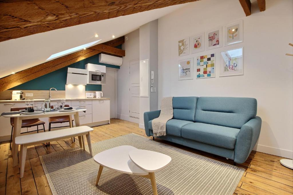 A seating area at Appartements Design Hypercentre
