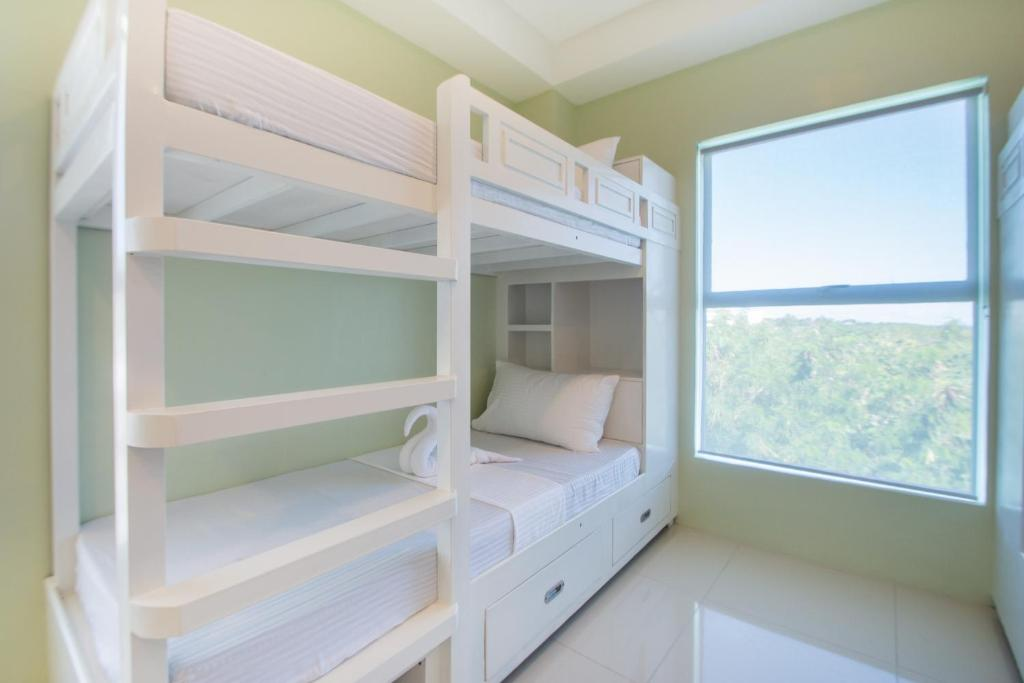 A bunk bed or bunk beds in a room at Shore Time Dormitel