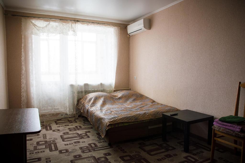 Кровать или кровати в номере Ice Arena Apartment