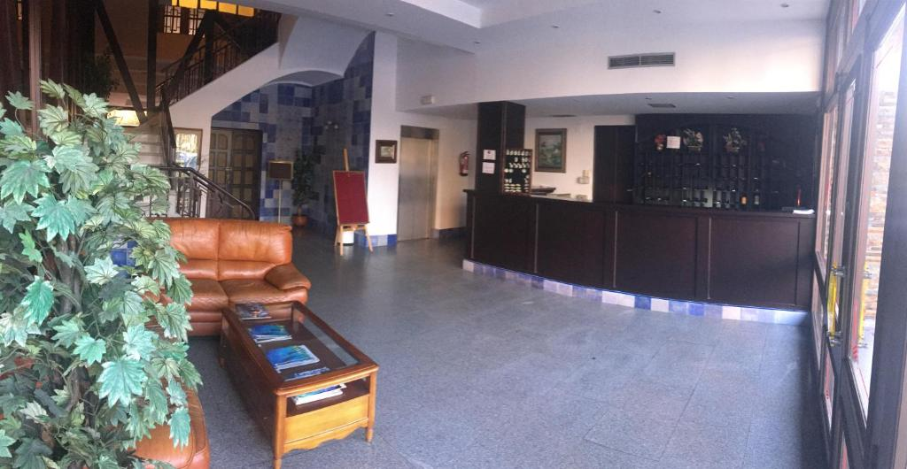 The lobby or reception area at Hotel Perales