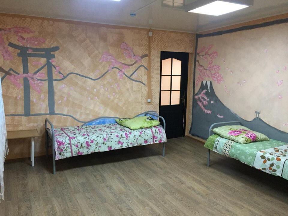 Кровать или кровати в номере Мини отель