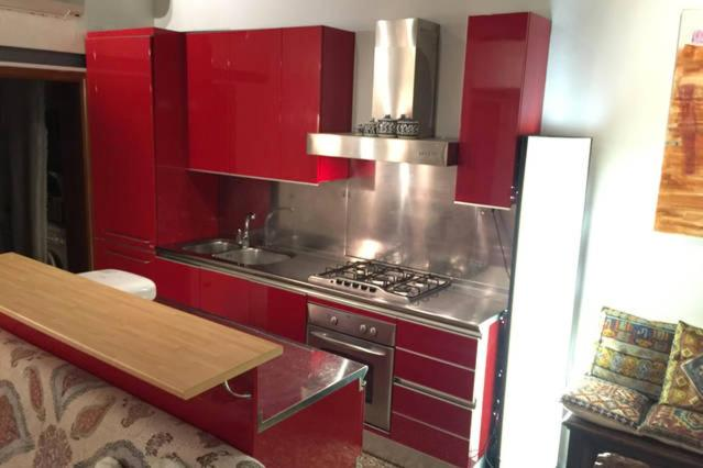A kitchen or kitchenette at Fenice apartment