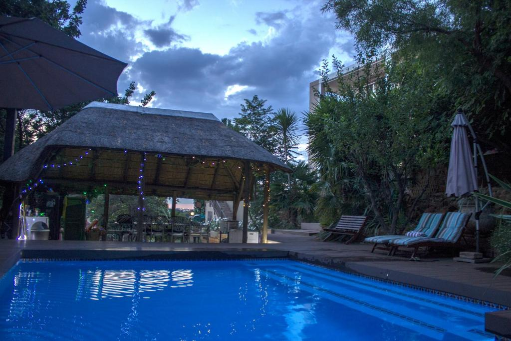 The swimming pool at or near Glenvista Guest House