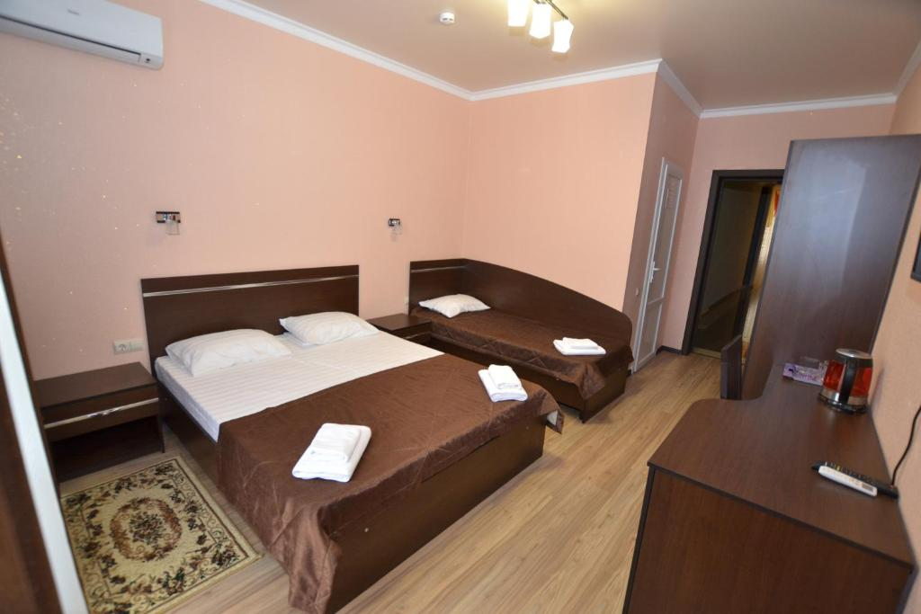 A bed or beds in a room at Guest House Azov