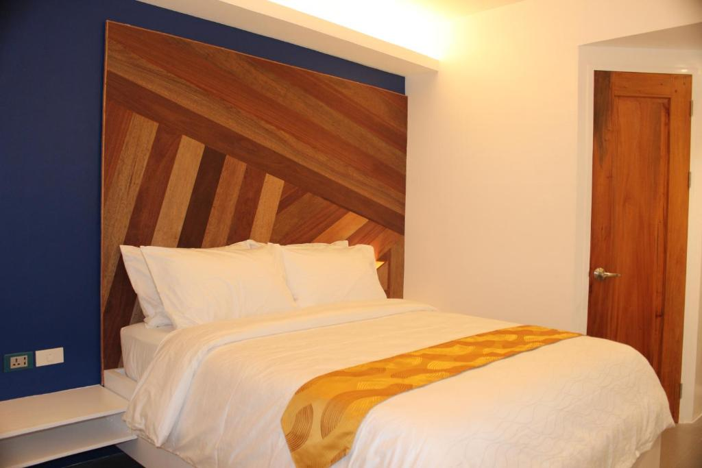 A bed or beds in a room at G Executive Hotel Boracay