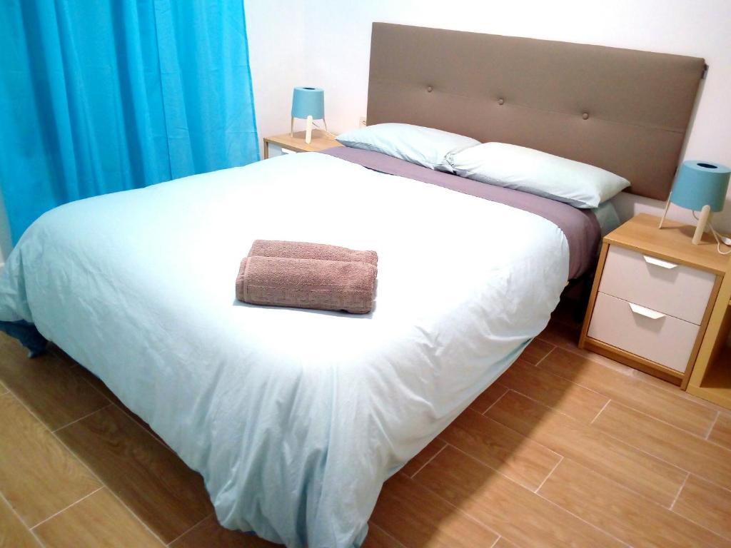 Cama o camas de una habitación en Enjoy Malaga Apartamentos Conde