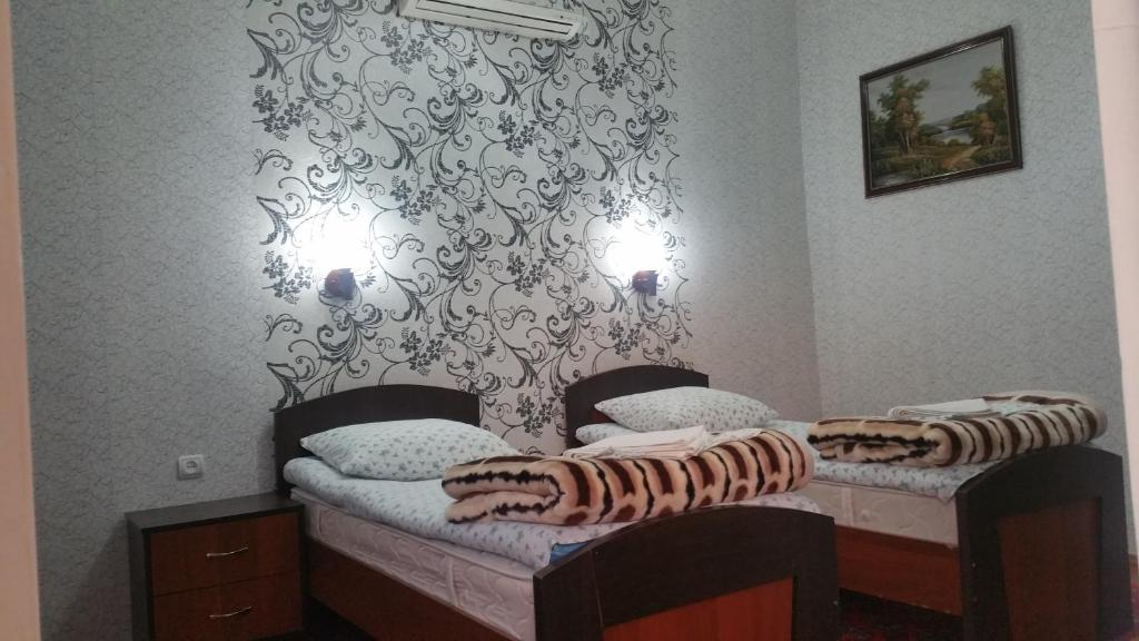 A bed or beds in a room at Gulnara Guesthouse