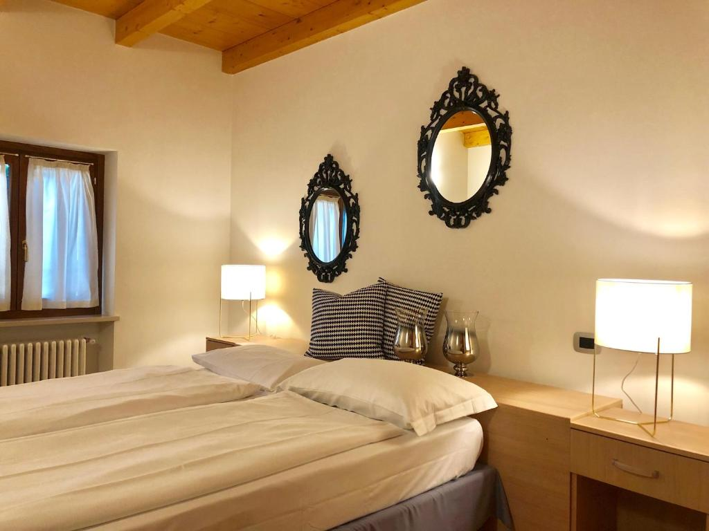 A bed or beds in a room at Pietra di Verona Residenza