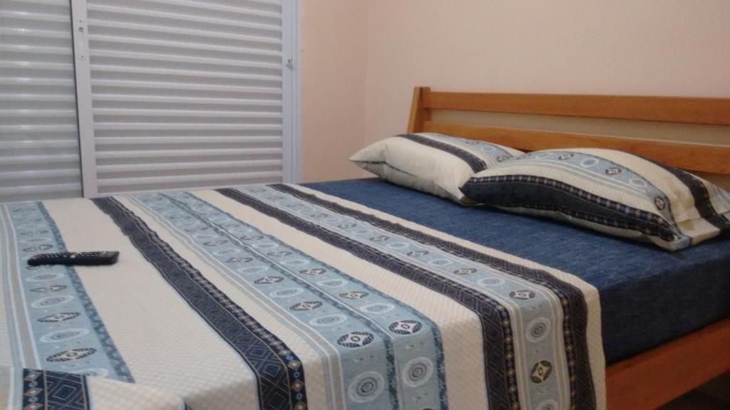 Cama ou camas em um quarto em Guerreiro Suites