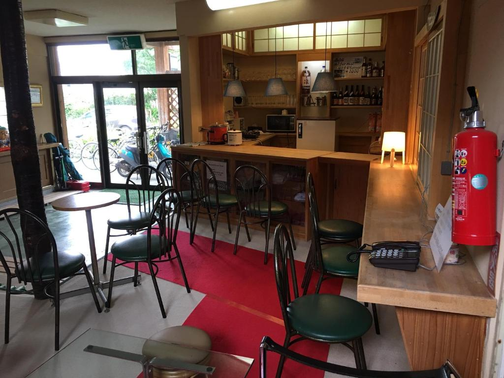 The lounge or bar area at Towadako Hostel
