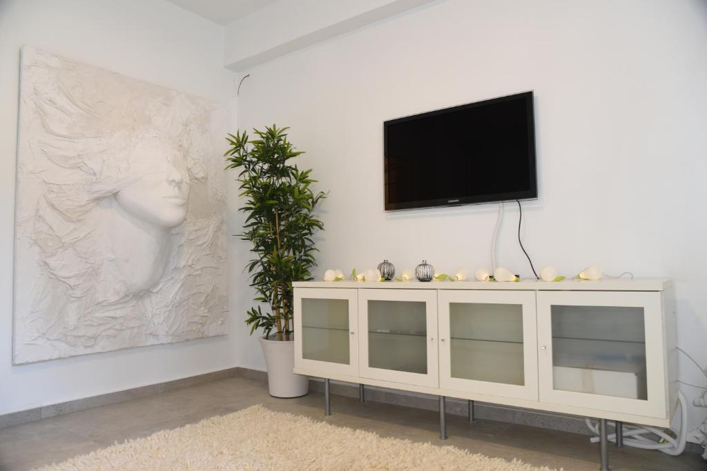 A television and/or entertainment center at Acropolis At Your Door