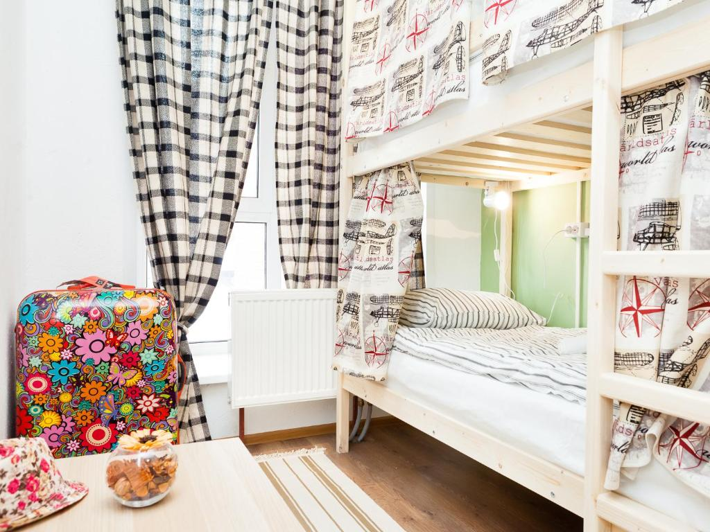 A bunk bed or bunk beds in a room at HostelsRus Domodevodo