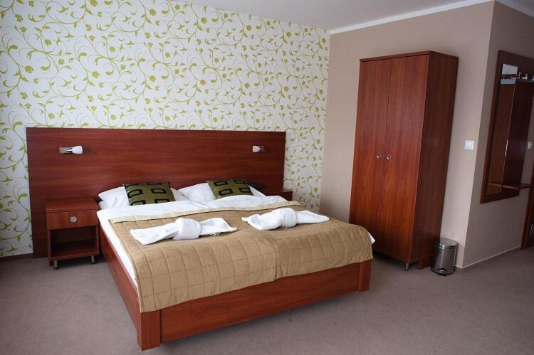 A bed or beds in a room at Hotel Centrum & Wellness