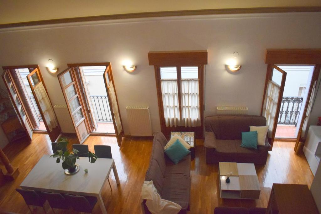 Coin salon dans l'établissement Apartamento Belmecher