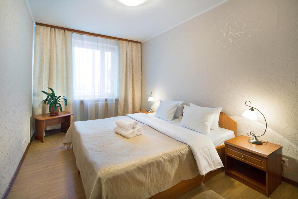 Кровать или кровати в номере Гостиница РАМН