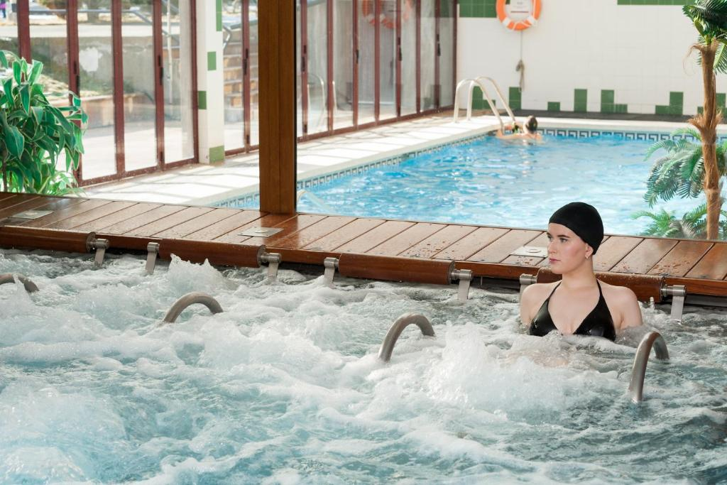 The swimming pool at or near SOMMOS Hotel Benasque Spa
