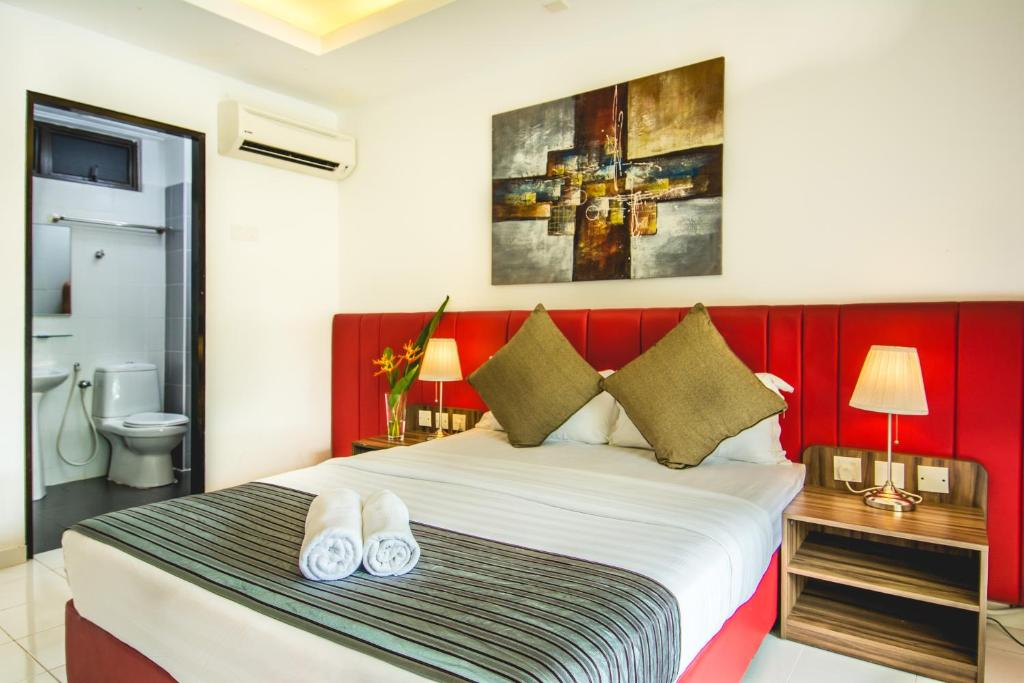 A bed or beds in a room at Alia Residence Business Resort