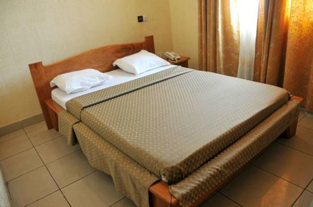A bed or beds in a room at First International Inn Newtown