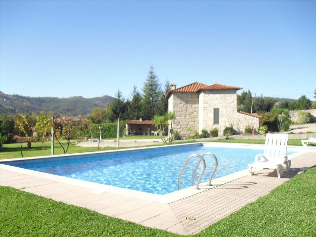 The swimming pool at or near Casa do Pomarelho