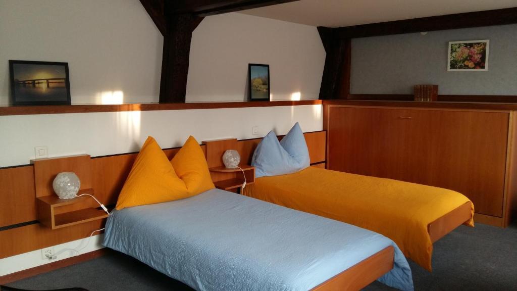 Ein Bett oder Betten in einem Zimmer der Unterkunft Auberge du Lion D'or