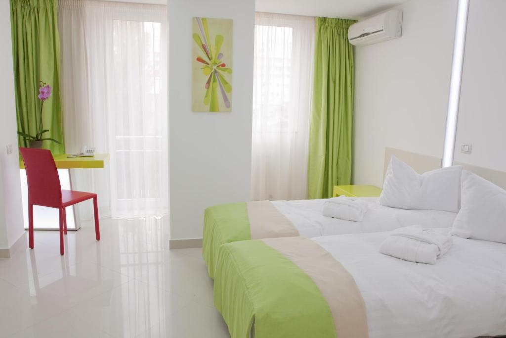 Letto o letti in una camera di Christina Hotel