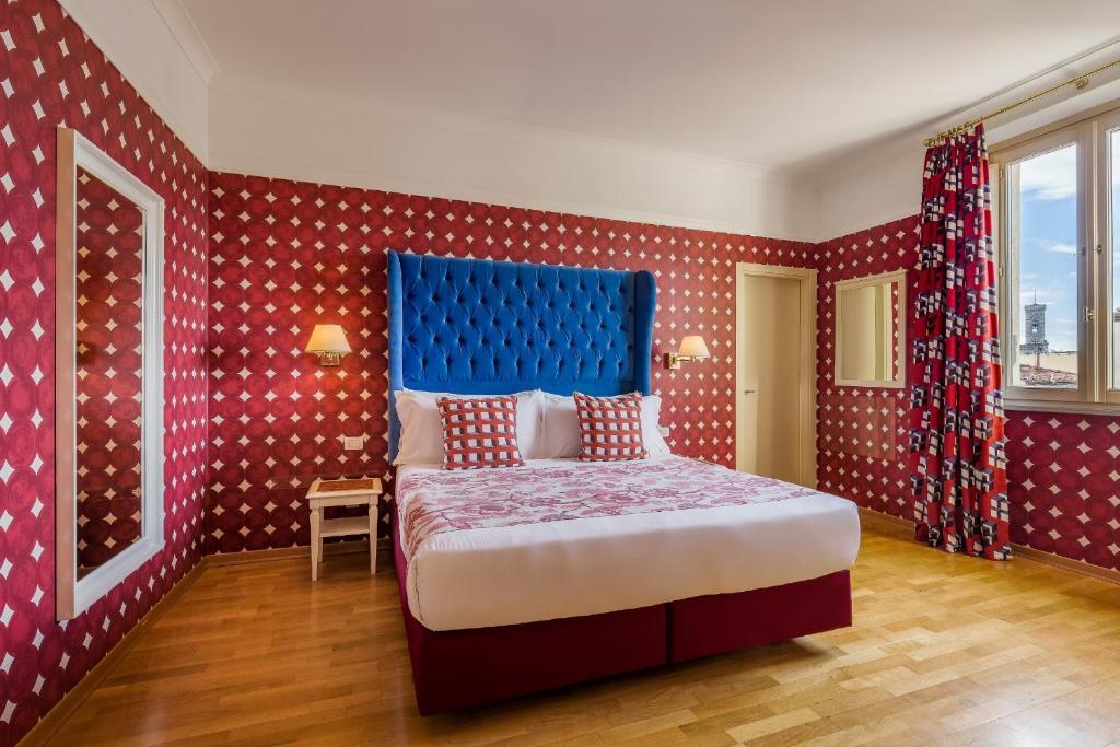 Ein Bett oder Betten in einem Zimmer der Unterkunft Room Mate Luca
