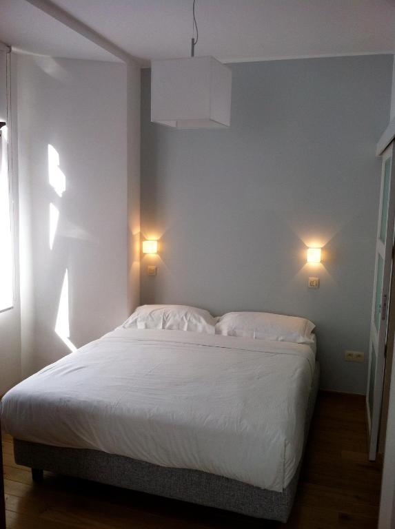 A bed or beds in a room at Apartment Art Déco Deuxième