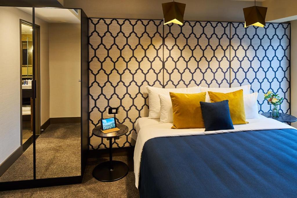 מיטה או מיטות בחדר ב-Bolton Hotel