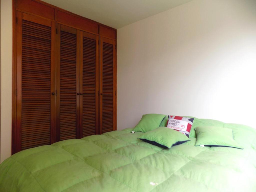 A bed or beds in a room at Double room and private Bathroom at Chapinero Alto