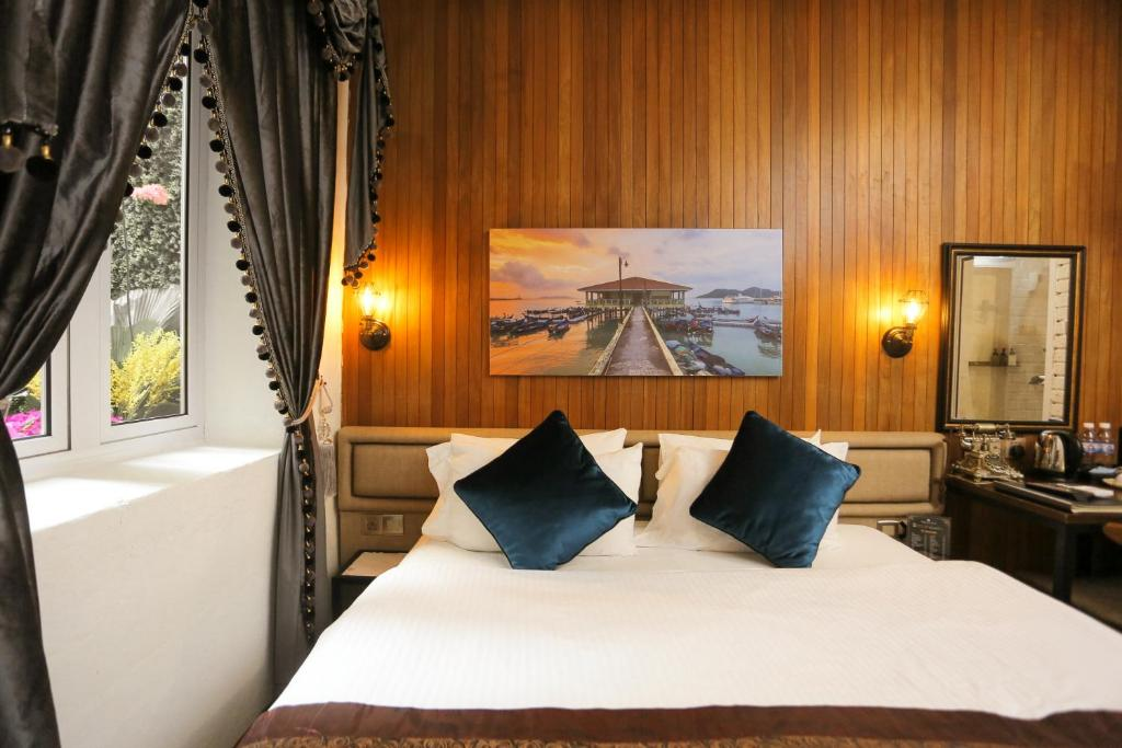 Cama o camas de una habitación en Reunion Heritage House