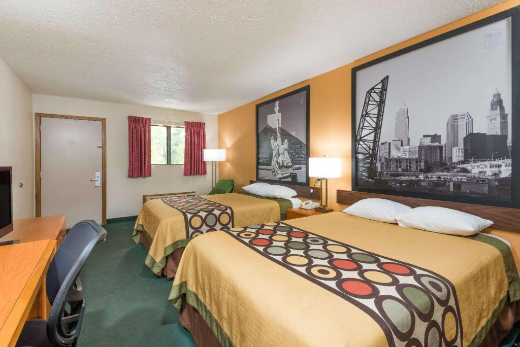A bed or beds in a room at Super 8 by Wyndham Westlake/Cleveland