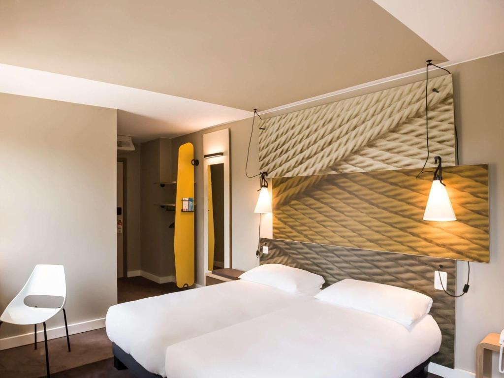A bed or beds in a room at Ibis Wavre Brussels East