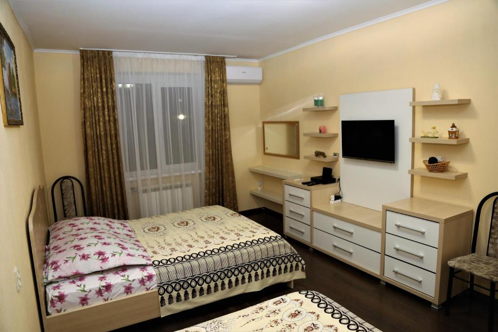 A bed or beds in a room at Апартаменты на Куйбышева 53