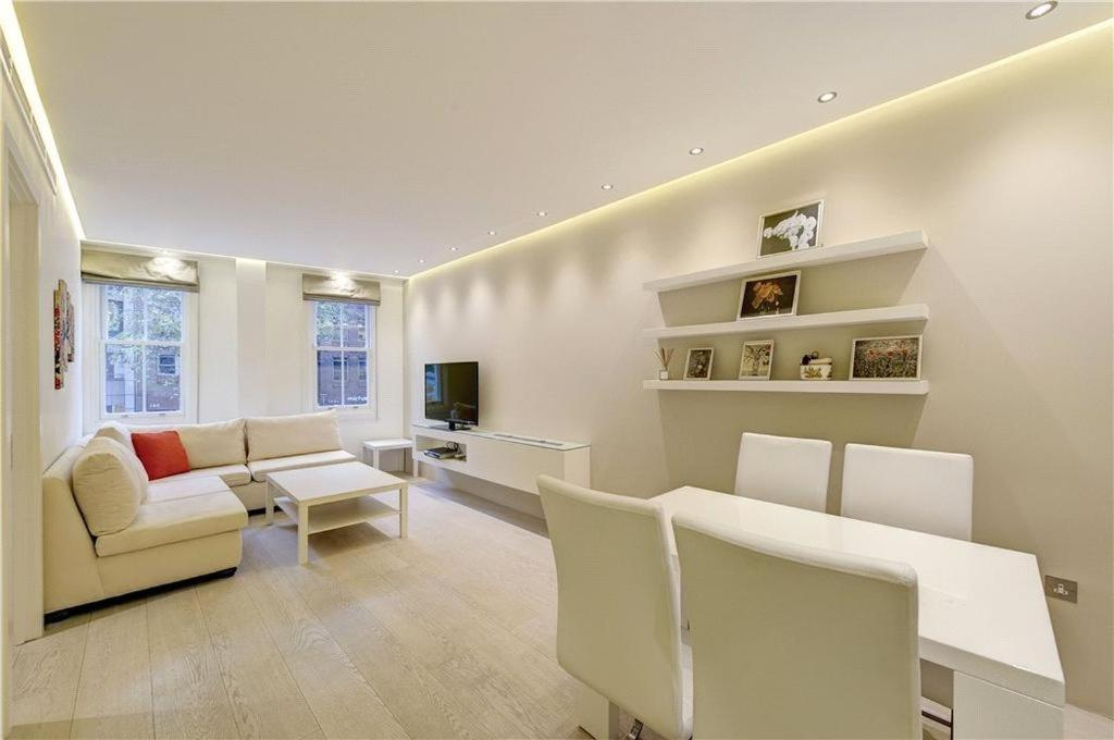A seating area at Heart of Knightsbridge - Stunning Air Conditioned Apartment - 1 minute walk from Harrods