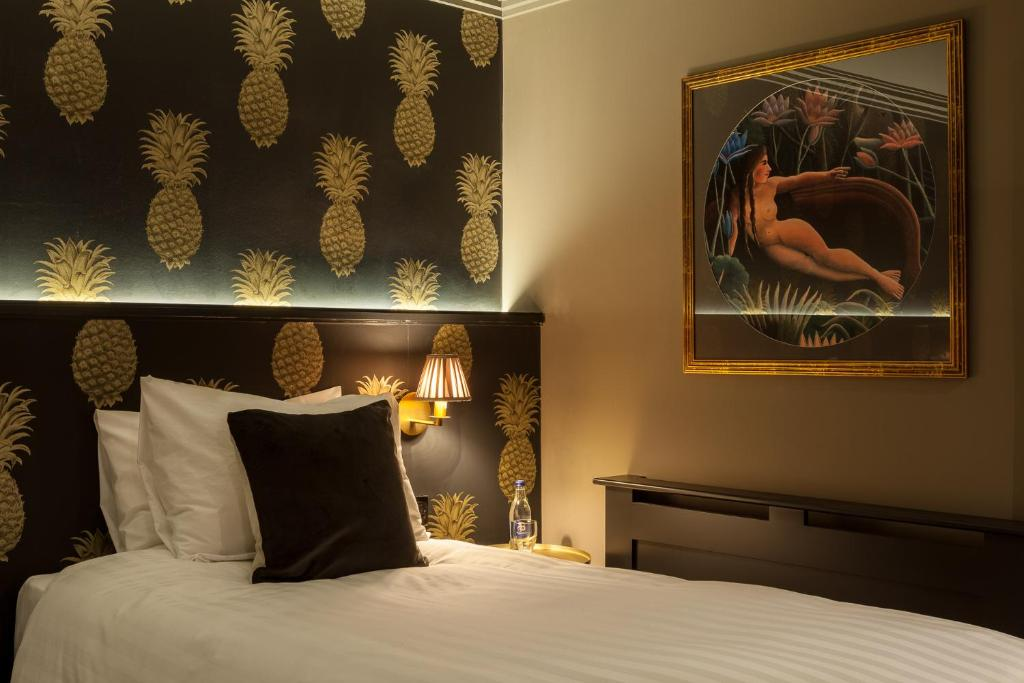A bed or beds in a room at House Belfast Hotel