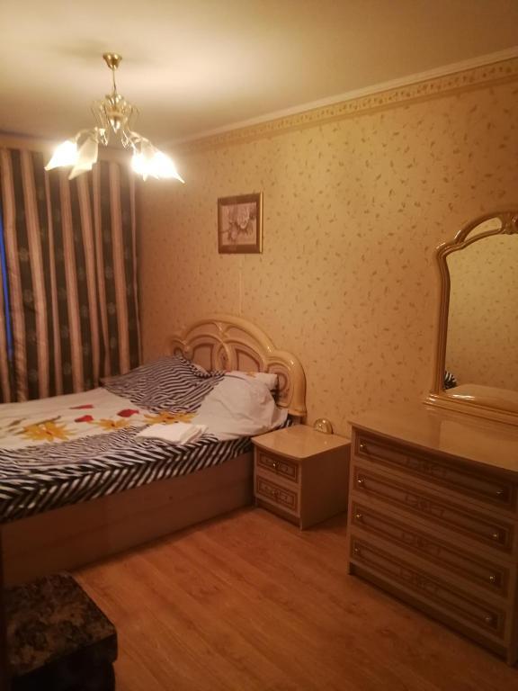 Кровать или кровати в номере Апартаменты на Тамбовской