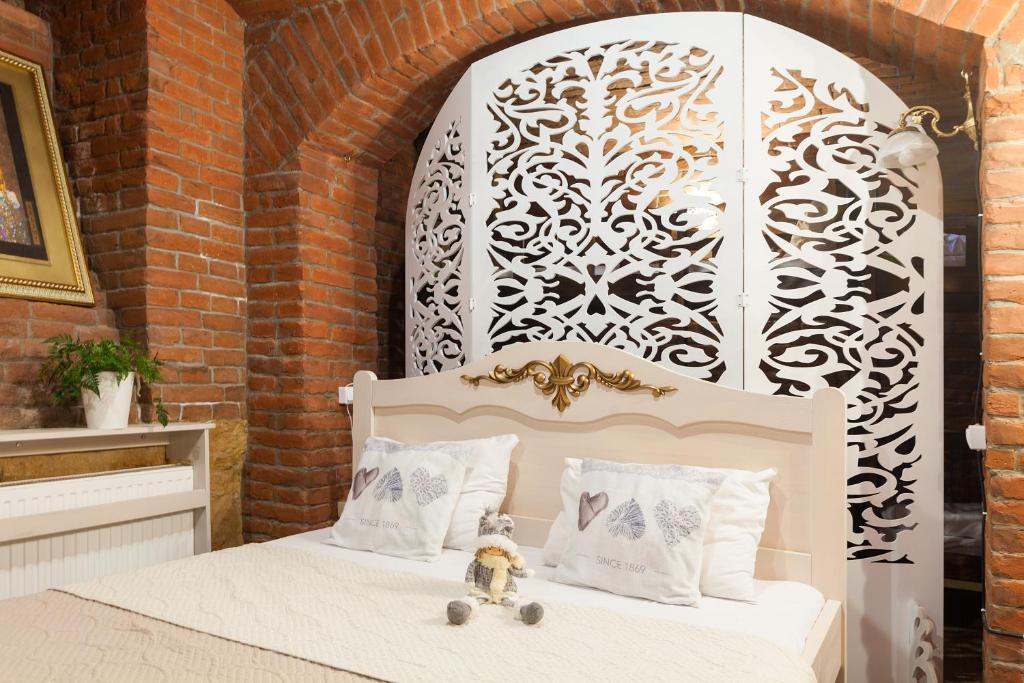 Ліжко або ліжка в номері Budget Family Hotel