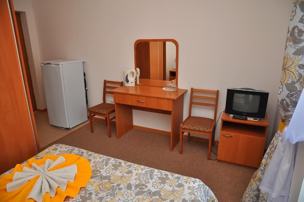 Телевизор и/или развлекательный центр в Гостевой дом «Атланта»