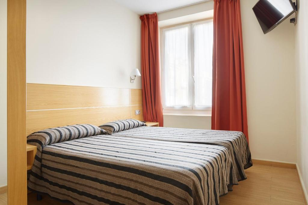 Cama o camas de una habitación en Musika Plaza